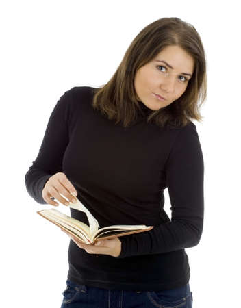 standing young woman in dark hair looking through book 