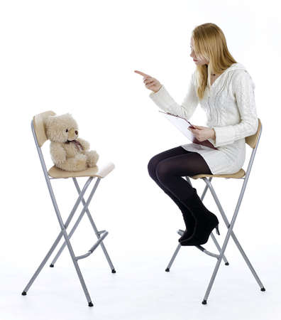 young lady teacher from clipboard explains bear Stock Photo - 6498153