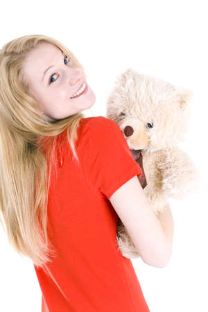 smiling blond hair young woman with Teddy bear Stock Photo - 6514650