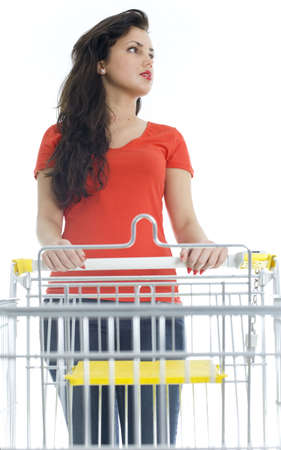 standing young woman with empty shopping cart Stock Photo - 6514645