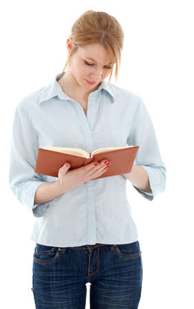 standing young woman in jeans holding book