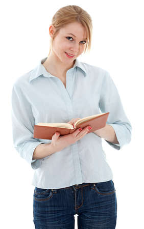 standing young woman in jeans holding book Stock Photo - 7865310