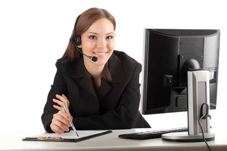 happy young customer service operator girl wearing headset, working on computer, smiling Stock Photo - 9034491