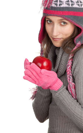 young woman in winter hat  and mittens with red apple Stock Photo - 9032158