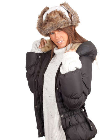 beautiful young brown woman wearing a warm winter hat and black coat