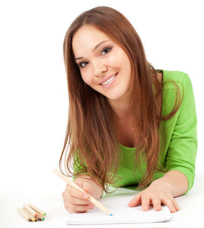 smiling young woman writing or painting on blank card Stock Photo - 9080194