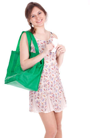 young woman with green ecological shopping bag checking purchases list Stock Photo - 9177159