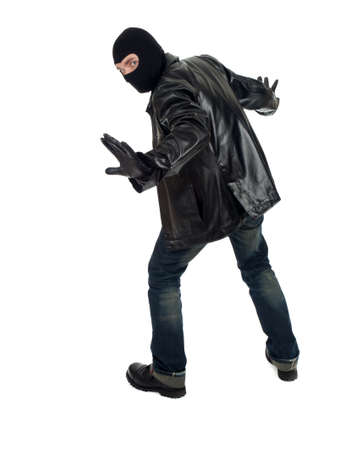 young male thief in balaclava and black leather jacket Stock Photo - 9516607