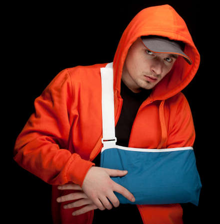 young man with broken hand wearing an arm brace Stock Photo - 9516791