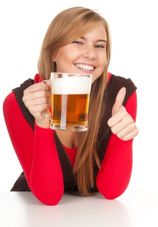 pretty girl with thumb up drinking beer from the mug photo