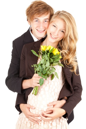 young happy pregnant couple with flowers, white background photo