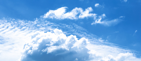 Beautiful cumulus clouds on a blue sky. Panorama of the heavenly phenomenon in the form of explosive clouds. Stock fotó