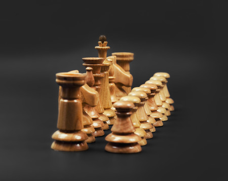 Chess. Figures on the position. Confrontation. Strategic game. Wooden Chess tournament on a black background. Banque d'images - 120477992