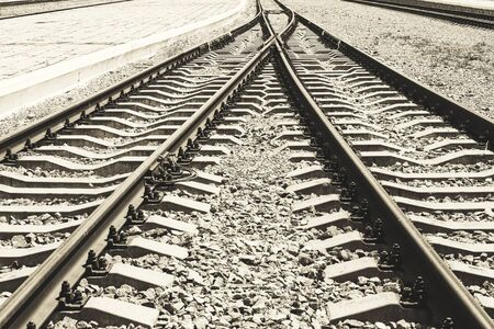 The convergence of two paths rail as a symbol of the inevitable unity of lives. Railway tracks with a platform.