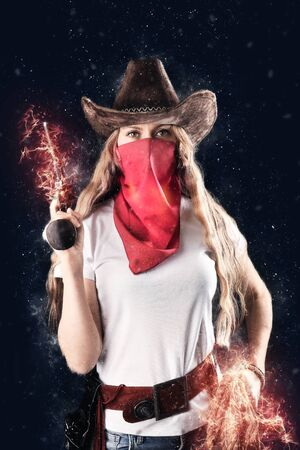 Beautiful cowboy girl with a fire gun and red bandana. Dangerous girl with a fire whip close-up. Brutal beautiful girl in the style of the Wild West Imagens