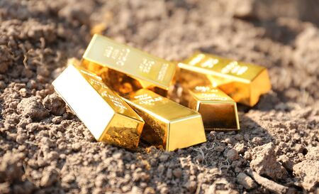 Black earth of people as gold bars. Land trade in countries. The value of the state is fertile land. Stok Fotoğraf