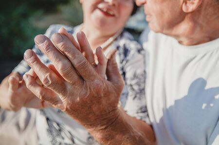 hands of an old couple in love