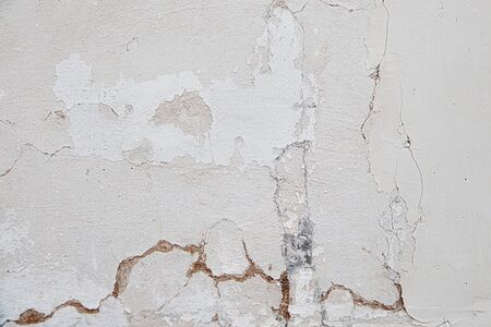 white wall with peeling plaster