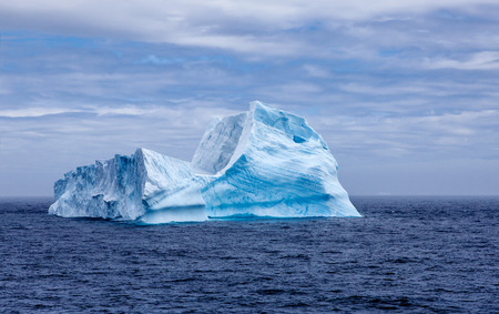 A huge iceberg adrift with a shape reminding the Sphinx of Egypt