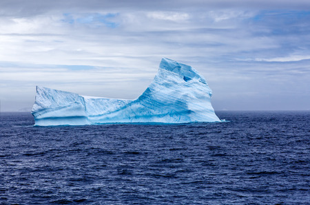 reminding: A huge iceberg adrift with a shape reminding the Sphinx of Egypt