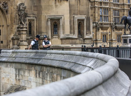 custodian: Two policemen London photographed outside the Palace of Westminster, on St  Margaret ST  talking and laughing quietly