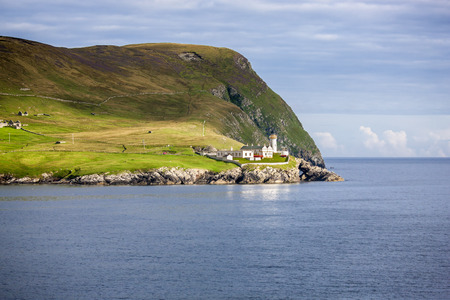 Beautiful lighthouse and buildings on the island of Bressay in the Shetland Islands in Scotland.
