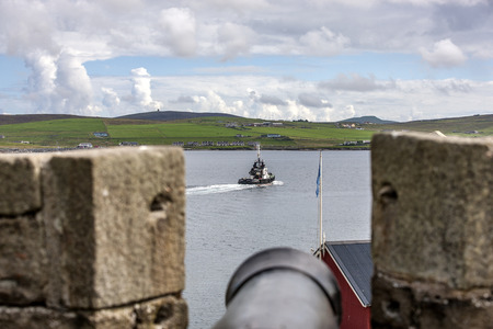 embrasure: Bressay Island viewed from Fort Charlotte Lerwick, Shetland, Scotland, United Kingdom. View from the embrasure for the cannon Editorial