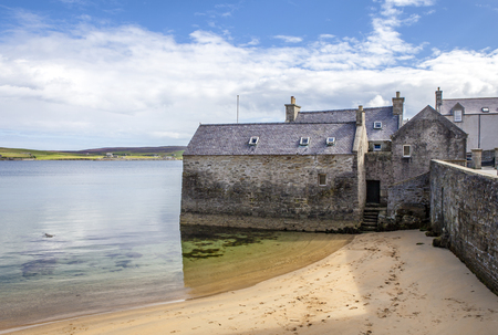 17th: Lerwick, Shetland, Scotland, United Kingdom. Old buildings dating from the 17th century near the port. Street View of the old city of 400 years with its characteristic granite houses in northern Europe. Stock Photo