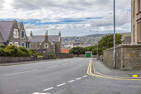 17th: Lerwick, Shetland, Scotland, United Kingdom. Street View of the old city of 400 years (17th century) with its characteristic granite houses in northern Europe. Stock Photo