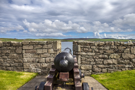 embrasure: Cannon, Rampart and Embrasure of Fort Charlotte, Lerwick, Shertland, Scotland. Bressay Island on background. Stock Photo