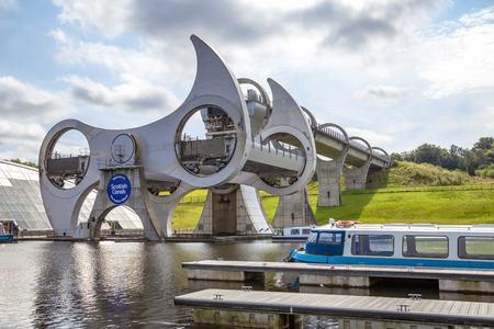 lift lock: The Falkirk Wheel is a rotating boat lift in Falkirk, Scotland, connecting the Forth and Clyde Canal with the Union Canal.