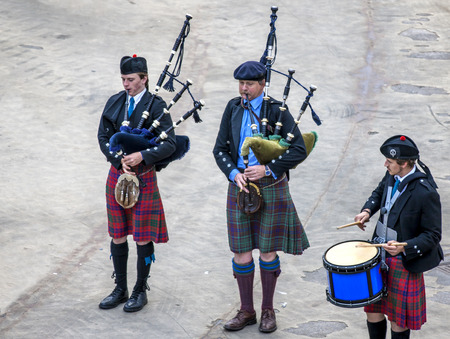 A Scottish band acts as host upon arrival of transatlantic ships in the port of Invergordon in Scotland committee.