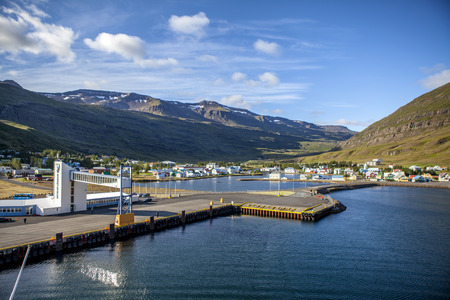 Seydisfjordur pretty quiet and serene town surrounded by mountains in Iceland.  View from the sea