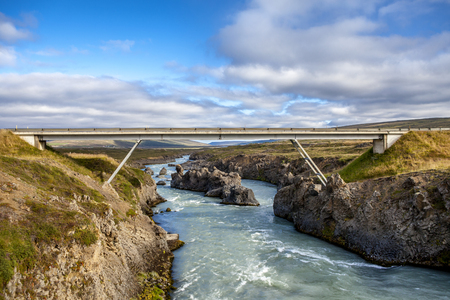 Car bridge across Skjalfandafljot river near Godafoss Waterfall in Iceland.