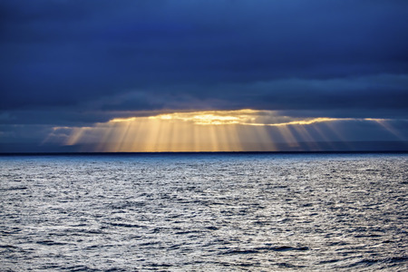 Sun through clouds to the sea, Greenland Sea north Iceland. Stock Photo