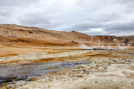 Geothermal region of Hverir in Iceland near Myvatn Lake, with fumaroles venting pressurised gases, sulphur springs and hot boiling mud from volcanic activity