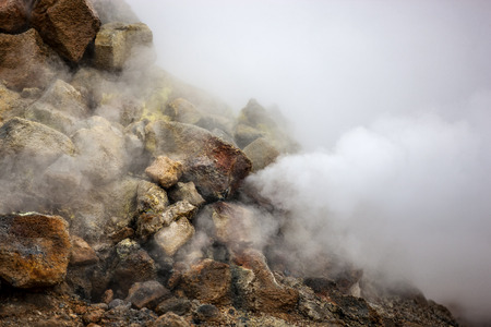 Fumarole evacuating pressurized gas from volcanic activity in the geothermal area of Hverir Iceland near Lake Myvatn.