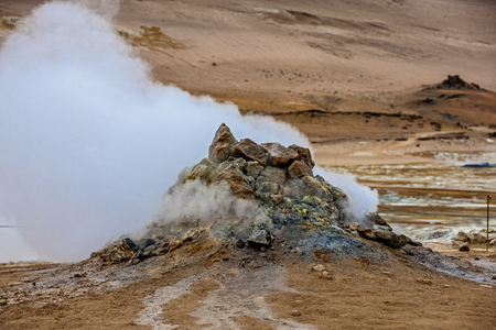 pressurized: Fumarole evacuating pressurized hot sulfurous gases from volcanic activity in the geothermal area of Hverir Iceland near Lake Myvatn.