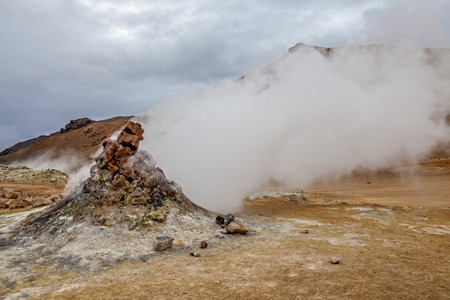 Fumarole evacuating pressurized hot sulfurous gases from volcanic activity in the geothermal area of Hverir Iceland near Lake Myvatn.
