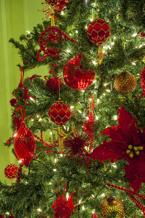 Detail of a Christmas tree, decorations and lights.