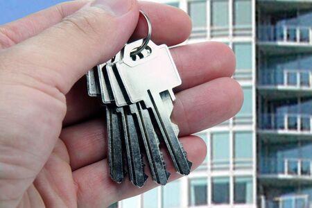 refinance: Real Estate agent hands over the keys.