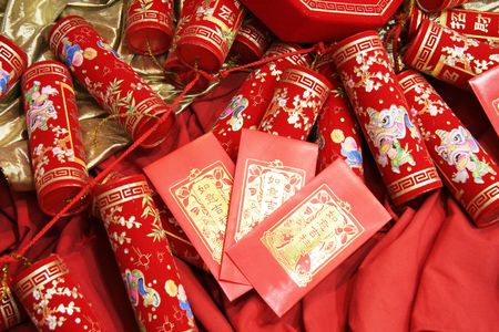 chinese celebration firecrackers and red envelope Stock Photo
