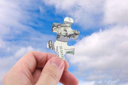 hand hold us dollar puzzle photo