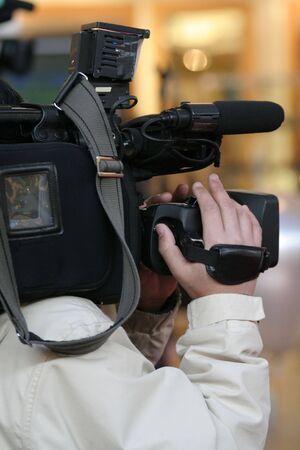 newsroom: cameraman and newscast