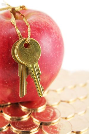 Golden key and red apple, concept of success photo