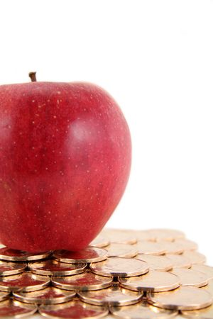 red apple and golden coin Imagens