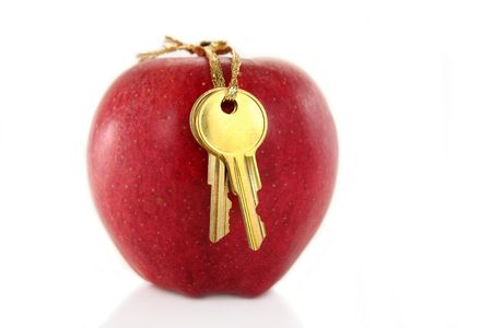 golden key and red apple photo