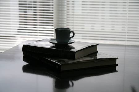 books lay on the table and coffee cup