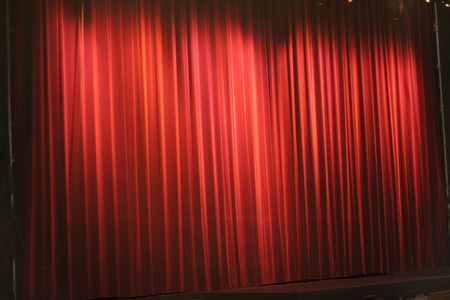 screen: red stage curtain, background pattern