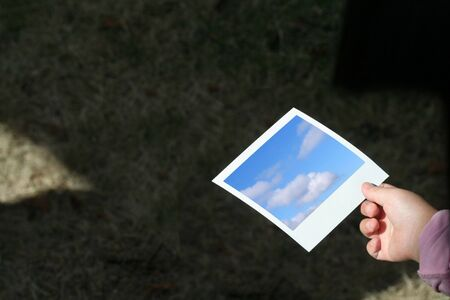photo story: child hand hold a photo, concept of future Stock Photo